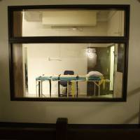 The death chamber at the  Washington State Penitentiary in Walla Walla is seen from the witness gallery and from within.   AP