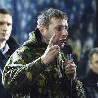 Volodymyr Parasiuk delivers an impassioned speech to a crowd of protesters as opposition leader Vitali Klitschko (left) looks on during a rally in Kiev on Friday night.   REUTERS