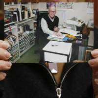 A photo of Australian missionary John Short is displayed by his wife, Karen, at the Christian Book Room in Hong Kong on Wednesday following his arrest in North Korea.   AP