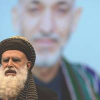 Rebranding?: Afghan presidential candidate and former Islamist warlord Abdul Rab Rasoul Sayyaf delivers a speech during an election gathering in Kabul on Thursday. | AFP-JIJI