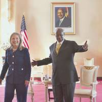 Then-U.S. Secretary of State Hillary Rodham Clinton is warmly greeted by Ugandan President Yoweri Museveni at the State House in Kampala on Aug. 3, 2012. | AP