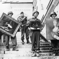 Art hero: James Rorimer (with notepad) supervises American soldiers as they carry paintings down the steps of Neuschwanstein castle in Bavaria, Germany, in May 1945. | AP