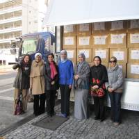 Initiative: Members of the Society of Wives of Arab Ambassadors, led by Chairwoman Shifa Haddad, wife of the Ambassador of Jordan (second from right), prepare to send the first shipment of humanitarian donations to Syrian refugee camps in Jordan on Feb. 6 at the Embassy of Kuwait in Tokyo. | EMBASSY OF QATAR