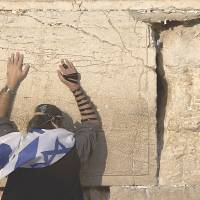 An Israeli prays at the Western Wall, considered Judaism's most sacred place for prayer, in Jerusalem. | AP
