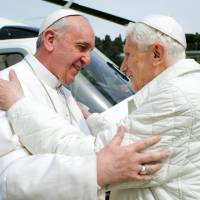 'Heartfelt friendship': Pope Francis meets Benedict XVI in Castel Gandolfo, Italy, last March. | AP