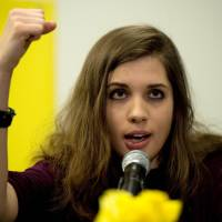 Dissenting voice: Nadezhda Tolokonnikova, of the band Pussy Riot, speaks at a news conference Tuesday in New York. | AP