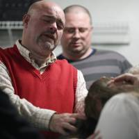 Pastor Jamie Coots prays at the Full Gospel Tabernacle in Jesus Name church on Dec. 11 in Middlesboro, Kentucky. Coots died Feb. 16 after being bitten by a rattlesnake. | AP