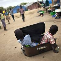 Children play in a camp housing displaced people from the Nuer ethnic group at the U.N. Mission in South Sudan's compound in Bor on Thursday. War crimes have been committed by all sides in the world's youngest nation, Human Rights Watch has reported. | AFP-JIJI