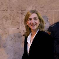On the defensive: Spanish Princess Cristina leaves the courthouse of Palma de Mallorca, on the Spanish Balearic Island of Mallorca, on Saturday. She is fighting to distance herself from accusations of fraud over a scandal that has plunged the royal family into crisis. | AFP-JIJI