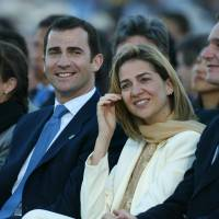 Privileged: From left, Princess Elena, Prince Felipe, Princess Cristina and her husband, Inaki Urdangarin, attend the Mass celebrated by Pope John Paul II in Madrid on May 4, 2003. | AFP-JIJI