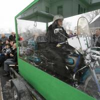 Final ride: The body of Bill Standley, secured to his 1967 Harley Davidson Electra Glide, rests inside a Plexiglass box during his funeral service on Friday in Mechanicsburg, Ohio. | AP