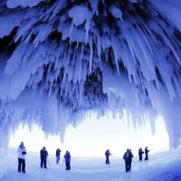 Winter wonderland: People visit a cave at the Apostle Islands National Lakeshore in northern Wisconsin, transformed into a dazzling display of ice sculptures by the Arctic siege gripping the upper Midwest, early this month. | AP