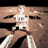 One small hop: China's first moon rover, Jade Rabbit, touches the lunar surface on Dec. 15 in this photo taken by the onboard camera of the lunar probe Chang'e-3 and shown on the big screen of the Beijing Aerospace Control Center.   AP