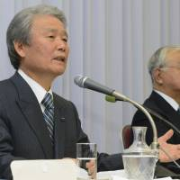 Big-biz bosses: Incoming Keidanren Chairman Sadayuki Sakakibara (left), who also serves as chairman of Toray Industries Inc., speaks beside the current head of the top business lobby, Hiromasa Yonekura, during a Jan. 27 news conference in Tokyo. | KYODO