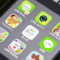 App icons for Line Corp.'s Internet messaging and calling service, controlled by Naver Corp., are displayed in this arranged photograph on an Apple iPhone 5s in Hong Kong on Tuesday. | BLOOMBERG