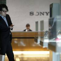 Considering the options: Visitors view Sony Corp. products at the company's headquarters in Tokyo on Feb. 6. | BLOOMBERG