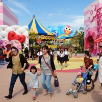 Families and students stroll in the Universal Studios Japan theme park in Osaka. | KYODO
