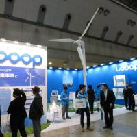 Looop Inc. displays a small-scale wind turbine at the Smart Energy Week 2014 trade show that started Wednesday in Tokyo Big Sight. | KAZUAKI NAGATA