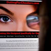 Raising eyebrows: A man looks at a dating site in Washington on Feb. 10. | AFP-JIJI