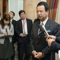 Akira Amari, minister in charge of the Trans-Pacific Partnership trade negotiations, responds to a reporter in Singapore on Monday. | KYODO