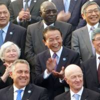 Finance Minister Taro Aso (second row, center), Bank of Japan Gov. Haruhiko Kuroda (top row, right) and U.S. Federal Reserve chief Janet Yellen (second row, left) pose with other finance ministers and central bank governors from the Group of 20 nations in Sydney on Saturday. | KYODO