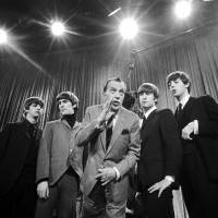 Ladies and gentlemen: Ed Sullivan stands with the Beatles in New York on Feb. 8, 1964, during a rehearsal for the British group's first American appearance, on 'The Ed Sullivan Show.' | AP
