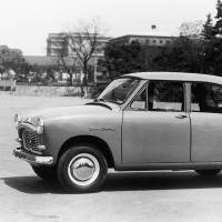 Wheels of fortune: The 1957 version of Toyota Motor Corp.'s longselling Corona sedan. The Toyoda family is said to have changed its corporate title to Toyota, which enables the name to be written with an auspiciously favorable eight brush strokes. | KYODO