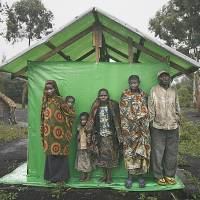 When it rains: Congolese pygmies take shelter from the rain in a village near Goma. | AFP-JIJI