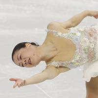 Akiko Suzuki of Japan performs her free skate during the women's figure skating event. | AP