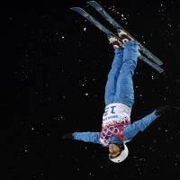 In her own world: Alla Tsuper competes in the women's aerials finals at Rosa Khutor Extreme Park during the Sochi Olympics on Friday. | AFP-JIJI