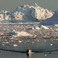 Next battleground: A boat moves through melting ice in the Ilulissat fjord, on the western coast of Greenland, in August 2008. The U.S. State Department recently announced plans to create an Arctic representative position to highlight the growing importance of that region. | AFP-JIJI