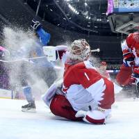 Finland ends Russia's hockey dream