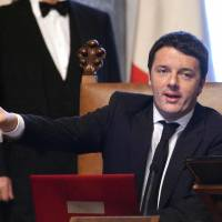 Newly appointed Italian Prime Minister Matteo Renzi rings a silver bell, marking the start of his office, before his first Cabinet meeting at Rome's Chigi palace on Saturday. | AFP-JIJI