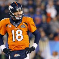 Tough to swallow: Peyton Manning pauses on the field during the second half of the Super Bowl.   AP