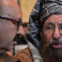 Peace talks: Taliban representative Maulana Sami-ul-Haq (right) speaks with the special assistant to Pakistan's prime minister, Irfan Siddiqui, prior to a joint news conference following a meeting in Islamabad on Thursday. | AFP-JIJI