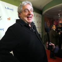 Actor and director Harold Ramis laughs as he walks the red carpet to celebrate the Second City comedy group's 50th anniversary in Chicago in December 2009. An attorney for Ramis said the actor died Monday morning from complications of autoimmune inflammatory disease. He was 69. Ramis is best known for his roles in the comedies 'Ghostbusters' and 'Stripes.' | AP