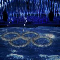 Performers re-create the fifth Olympic ring that didn't open in the opening ceremony during the closing ceremony of the 2014 Winter Olympics on Sunday in Sochi, Russia. | REUTERS