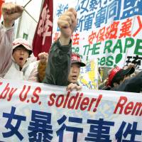 Stoking anger: Protesters shout slogans during a rally against an alleged rape in February of a 14-year-old girl by an American serviceman in Okinawa Prefecture in March 2008. An Associated Press investigation into the military's handling of sexual assaults in Japan has found a pattern of random and inconsistent judgments in which most offenders are not incarcerated. Instead, commanders have ordered 'nonjudicial punishments' that ranged from docked pay to a letter of reprimand. | AP