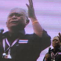 Thai protest leader Suthep Thaugsuban addresses supporters during a rally at a protest camp in central Bangkok on Tuesday. | AFP-JIJI