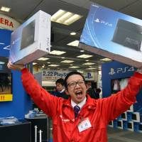 Gamers across Japan finally get their hands on Sony's PS4 console