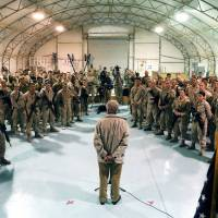 U.S. Defense Secretary Chuck Hagel speaks with troops at Camp Bastion, Afghanistan, in December. President Barack Obama has ordered the Pentagon to plan for a full American withdrawal from Afghanistan by the end of this year. | AP