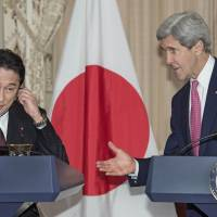 United: Foreign Minister Fumio Kishida (left) and U.S. Secretary of State John Kerry speak to reporters after a closed-door bilateral meeting Friday in Washington. | AFP-JIJI