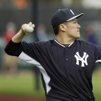 Getting down to business: Yankees hurler Masahiro Tanaka plays catch during spring training on Saturday in Tampa, Florida | AP