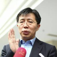 Ji Wenlin, vice governor of Hainan province, speaks to reporters in south China's Hainan province on Feb.10. The ruling Communist Party said Tuesday that Ji is currently under investigation for corruption, making him the latest in a string of high-ranking officials to come under scrutiny since President Xi Jinping became head of the Communist Party last spring. | AP