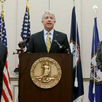 Virginia Attorney General Mark Herring, flanked by Solicitor General Stuart Raphael (left) and Chief Deputy Attorney General Cynthia Hudson, speaks Friday in Richmond after a federal judge struck down Virginia's ban on gay marriage, which Herring also considers unconstitutional. | AP)