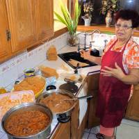 Self-starter: Hilda Vasquez makes tamales in her kitchen in Edinburg, Texas, on Dec. 4, 2013. While Vasquez managed to raise the $680 for her U.S. citizenship application by selling batches of the tamales at South Texas offices, immigration advocates are concerned that current reform proposals could more than triple the cost of citizenship for those illegally in the country, making the financial hurdles almost insurmountable. | AP