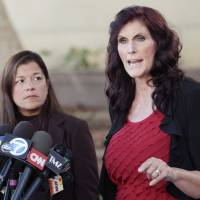 "This Sept. 20, 2012, file photo shows Cindy Lee Garcia (right), one of the actresses in the film ""Innocence of Muslims,"" and attorney M. Cris Armenta at a news conference before a hearing at Los Angeles Superior Court in Los Angeles. 