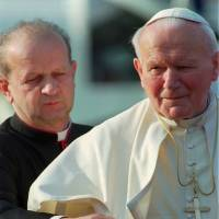 Papal traitor?: Pope John Paul II (right), is pictured with personal secretary Stanislaw Dziwisz during a trip to northern Italy. Poles are divided between praise and condemnation of Dziwisz for choosing to publish the beloved pontiff's personal notes against his last will and testament, in which he ordered them burned. | AP
