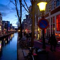 Red Light Secrets: The entrance of the Red Light Secrets prostitution museum is seen at right in Amsterdam. | AP