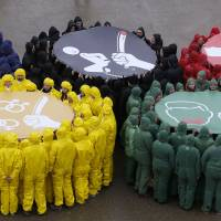 Color us angry: Activists protest against human rights violations in Russia on Saturday in Paris ahead of the Sochi Winter Olympics. | AFP-JIJI